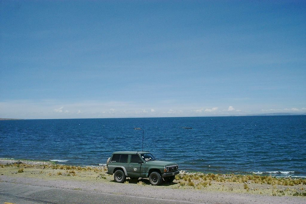 OA/HC1ACW/M travel Peru South America Mobile Ham radio station. Nissan Patrol, Transceiver IC-706MKII, Mobile Antenna MFJ, HF Stick. Lake Titicaca, straddling the border between Peru and Bolivia.